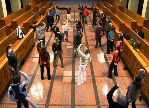 Students practice qigong in Bastyr Chapel