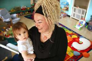 Head provider Michele Tobias with a child the Bastyr Parent Resource Center.