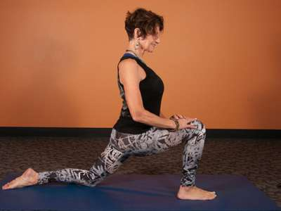 Yin yoga instructor Pam Granston demonstrates dragon posture.