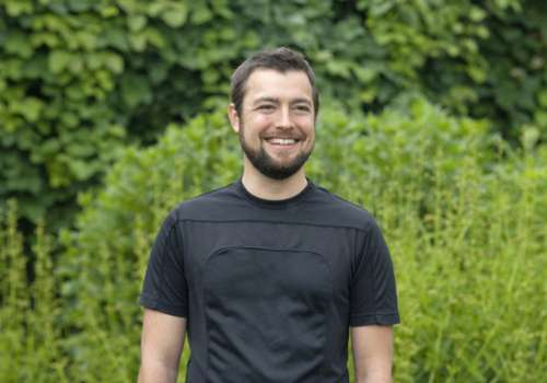 Joshua Goldenberg, ND, in Bastyr campus garden