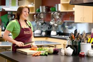 Elizabeth Lipman chops vegetables in the whole-foods nutrition kitchen.